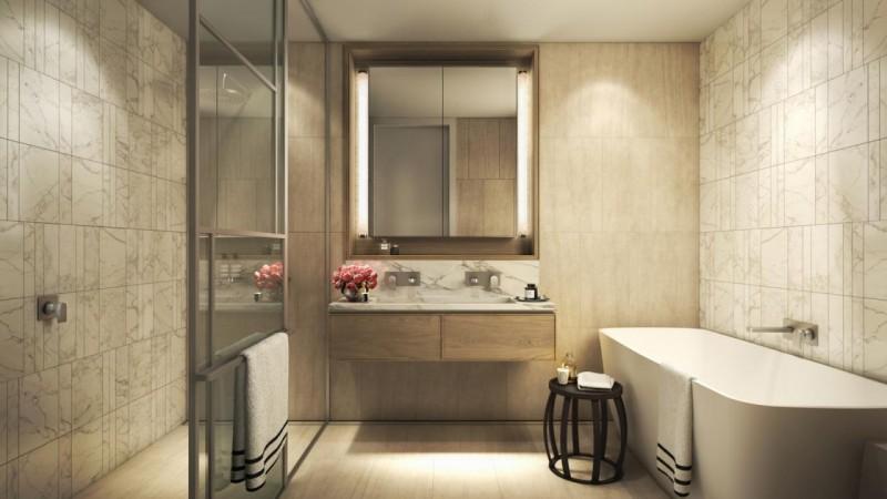 主卧卫生间配有独立浴缸和大理石镶嵌的墙面