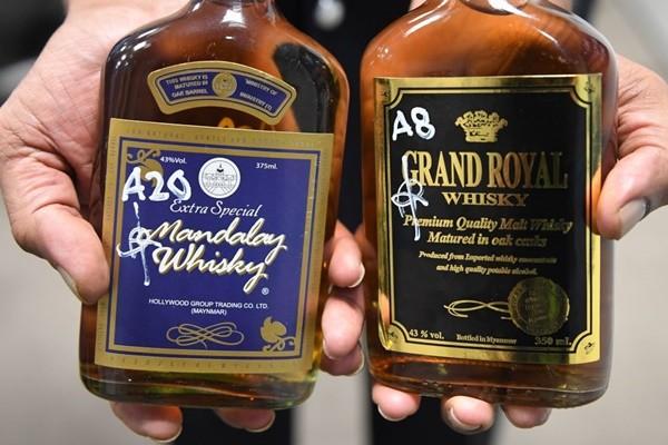 马来西亚假酒 导致数十人中毒身亡