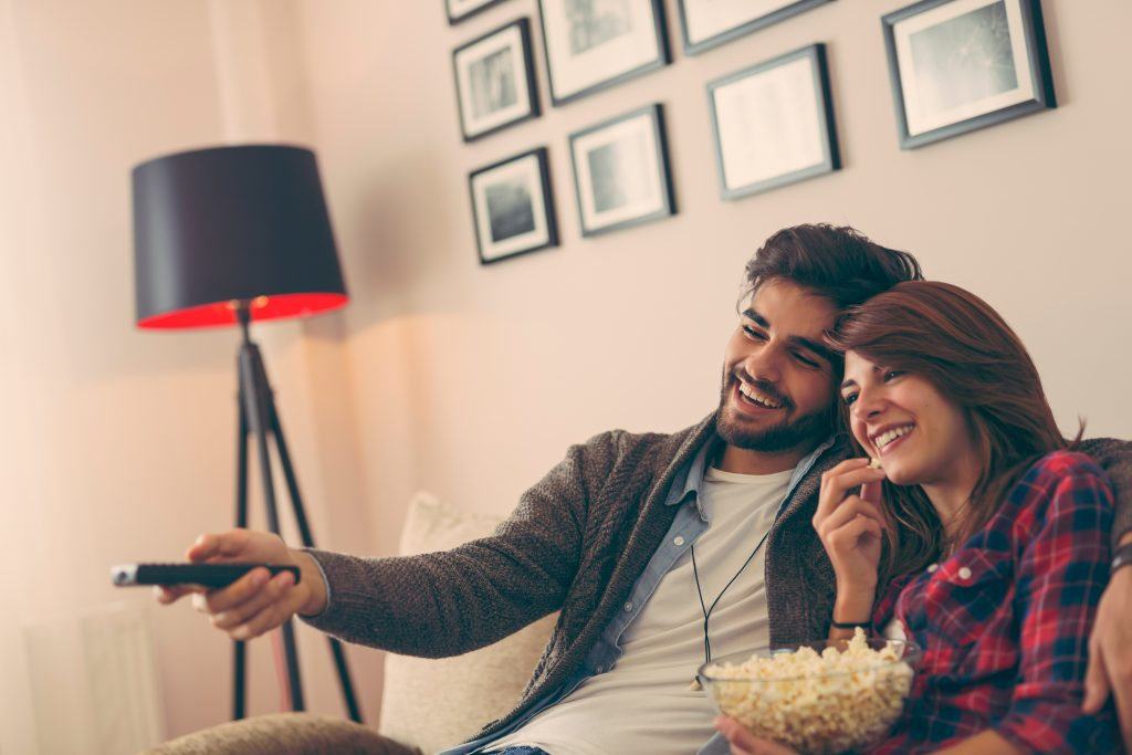 Young couple watching movie
